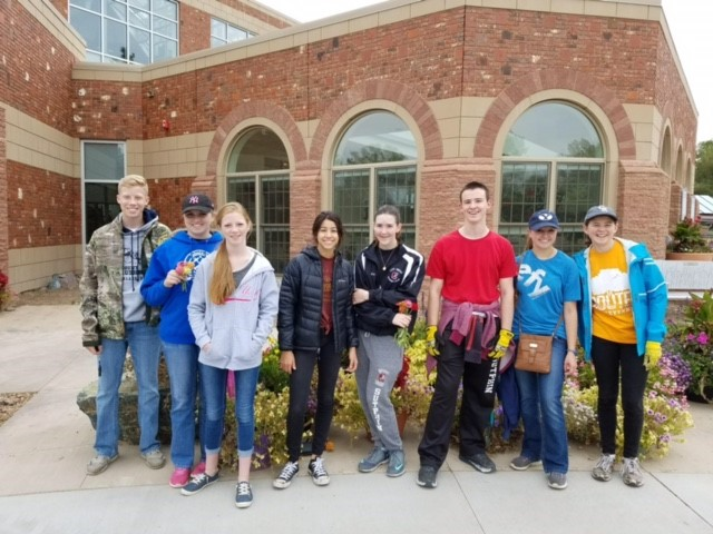 Interact Members Clean-up Around Conservatory