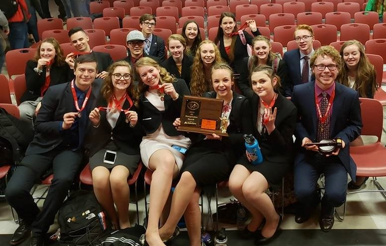 Members+of+Central%27s+Speech+and+Debate+team+pose+with+their+hardware+after+winning+2nd+place+at+their+recent+State+Competition+in+Riverton.